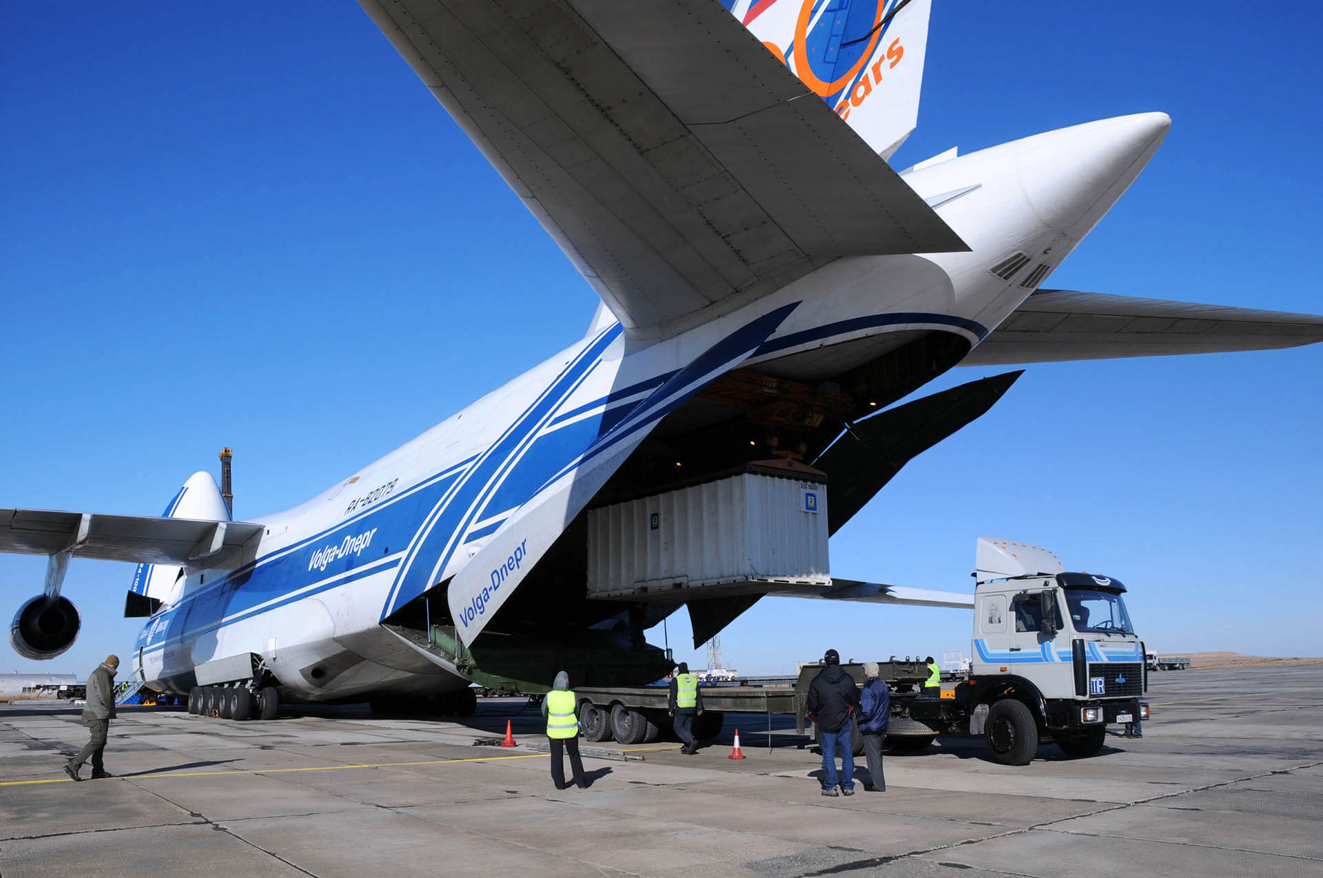 Cargo plane loading a container